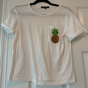 White tee with pineapple pocket